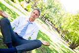 Businessman doing yoga in park