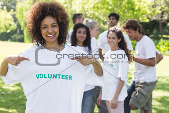 Happy volunteer pointing at tshirt