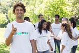 Confident volunteer showing thumbs up