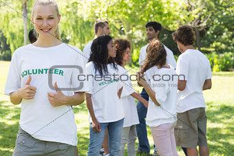 Beautiful volunteer gesturing thumbs up