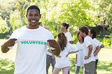Portrait of happy volunteer holding tshirt