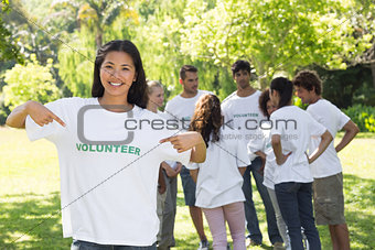 Beautiful volunteer pointing at tshirt