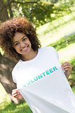 Environmentalist holding volunteer tshirt