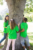 Environmentalists standing around tree