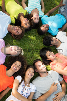 Group of friends lying down in park