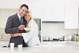 Woman embracing well dressed man in the kitchen