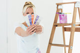 Blurred woman holding color swatches in a new house