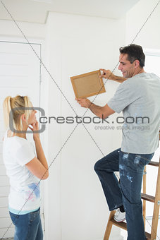 Couple decorating their new house