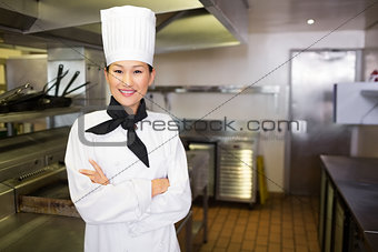 Portrait of smiling female cook in kitchen