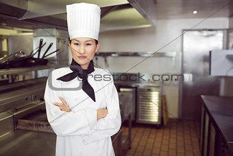 Portrait of confident female cook in kitchen