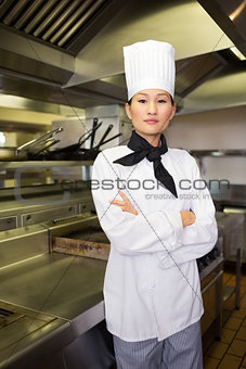 Portrait of confident female cook in kitchen