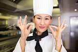 Closeup of a smiling female cook gesturing okay sign