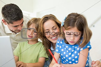 Family spending leisure time at home