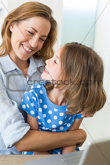 Affectionate mother embracing daughter