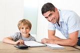 Father assisting son with homework