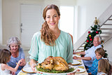 Smiling mother with Christmas meal