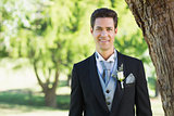 Groom smiling at garden