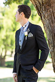 Bridegroom looking away in garden