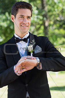 Bridegroom waiting in garden