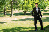 Confident groom standing in garden