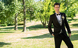 Handsome bridegroom standing in garden
