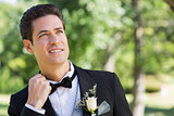Nervous groom in garden