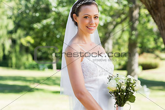 Bride with flower bouquet in garden
