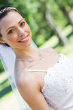 Smiling bride in garden