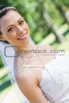 Smiling bride in garden
