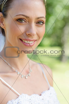 Portrait of bride smiling in garden