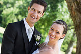 Happy young bride and groom in garden