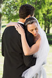 Bride embracing groom on wedding day