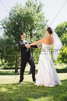 Bride and groom enjoying in park