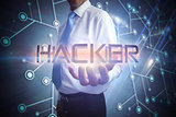 Businessman presenting the word hacker