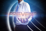 Businessman presenting the word prevent