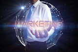 Businessman presenting the word marketing