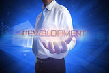 Businessman presenting the word development