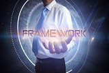 Businessman presenting the word framework