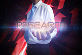 Businessman presenting the word research