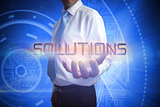 Businessman presenting the word solutions