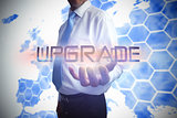 Businessman presenting the word upgrade