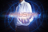 Businessman presenting the word industry