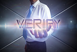 Businessman presenting the word verify