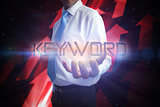 Businessman presenting the word keyword