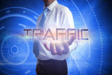Businessman presenting the word traffic