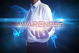 Businessman presenting the word awareness