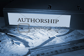 Authorship on blue business binder