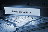 Board committees on blue business binder
