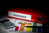 Insurance on red business binder