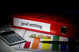 Goal setting on red business binder
